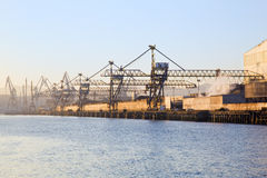 Sea port cranes. Close to the scrap yard of a steel mill Royalty Free Stock Photo