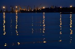 Sea port in the evening with the reflection of light from the lanterns on the water. stock photo