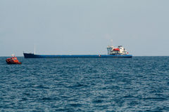 Sea port. Large cargo ship in the sea Royalty Free Stock Photos