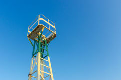 Sea port lighthouse tower. With lookout and blue sky Royalty Free Stock Photo