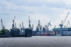 Many cranes and ships on the dock royalty free stock image