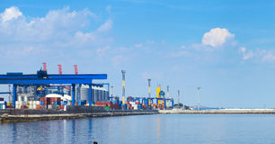 Sea Port in Odessa, Ukraine, 2016. Hoisting crane and ship Stock Photo