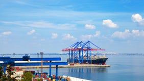 Sea Port in Odessa, Ukraine, 2016. Hoisting crane and ship Royalty Free Stock Photos