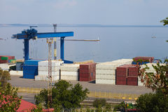 Sea Port in Odessa, Ukraine, 2016. Hoisting crane and ship Royalty Free Stock Images