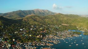 Coron town aerial view. Philippines, Palawan, Busuanga. Sea port, pier, cityscape Coron town with boats on Busuanga island, Philippines, Palawan. Coron city with stock image