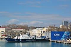 Sea port of Sochi. SOCHI, RUSSIA - MAR 22, 2014: The urban cityscape. The ship of the coast guard and Olympic symbolics in the sea port of Sochi Stock Images