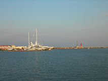 Sea port, Sochi Yacht Marina. Boats docked, lighthouse, blue sea and sky Stock Photo
