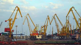 Sea port. Visible cranes, freight train. Odessa, Ukraine - June 26, 2016: Sea port. Visible cranes, freight train. Video was obtained in a public place in the stock video