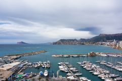 Port of Calpe. Sea port and yacht club of Calpe, Alicante, Spain in cloudy weather Royalty Free Stock Image