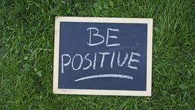 Sea positivo escrito Fotos de archivo