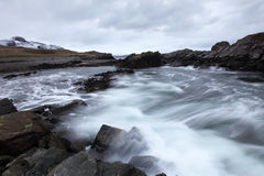 Sea power. Wave flowing over rocky bay at Cold Backie in north Scotland Royalty Free Stock Images