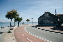 Sea promenade in summer sunny day. Asphalt road near the port and sea promenade in summer sunny day in Ogrove, Spain Stock Images