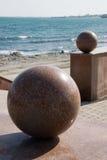 Sea quay. Granite spheres decorate sea quay Stock Images