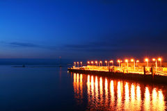 Sea quay at night. Sea quay at night with lights reflection Royalty Free Stock Images