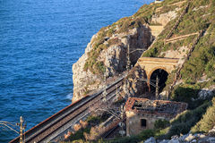 The sea and the railway tunnel near the town of El Garraf. Spain. The Mediterranean sea and the railway tunnel near the town of El Garraf. Catalonia, Spain Stock Photo