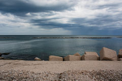 Sea in a rainy day in Bari. Sea view with clouds and rain on the horizon in Bari, Italy Stock Photos