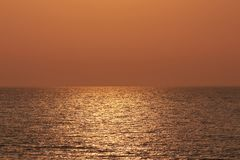 Sea in the rays of the rising sun - Beautiful golden water color.  stock images