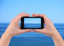 Sea reflection on screen. Cell phone. Whole background Royalty Free Stock Photos