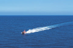 A sea rescue boat patrolling near the Island of Palma in the Mediterranean sea. A high angle image of a sea rescue boat patrolling near the Island of Palma in Stock Photo