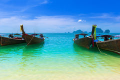 Blue water, cloudy sky and traditional fishing boats Stock Photo