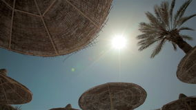 Sea resort travel sun shines through sunshade stock video