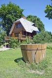 Sea resort villa house and wooden bath tank Royalty Free Stock Images