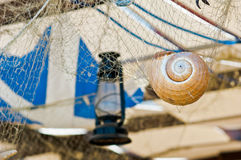 Sea restaurant ceiling decoration. With net and seashell Stock Image