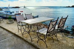 Sea Restaurant with Wooden Tables and Chairs on the Sea Shore with Sea View. Cozy Sea Restaurant with Wooden Tables and Chairs with Sea View stock photo