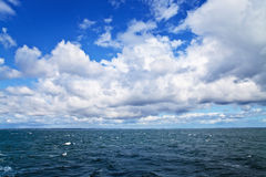 Sea ripples and cloudy sky Royalty Free Stock Photo