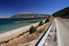 Sea, road, beach, mountans Stock Image