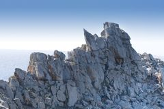 Sea and rock. Beautiful view with stone rock sea and blue sky Stock Photography