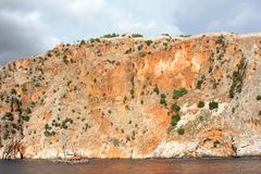 Sea rock. Sea landscape with a high unapproachable rock and fortification lasting on it Royalty Free Stock Photography