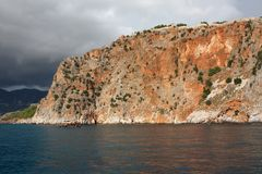 Sea rock. Sea landscape with high unapproachable rock and an approaching thunder-storm Stock Photography