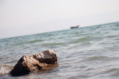 Sea rock. Underwater stones protrude out of sea level Royalty Free Stock Photo