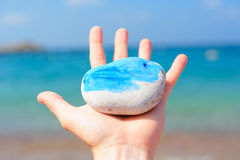 Sea rock in a hand Royalty Free Stock Images