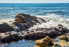 Sea rock stone formation wave spray Royalty Free Stock Photos