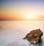 Sea and rock at the sunset Royalty Free Stock Photography