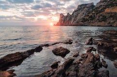 Sea, rock, sunset Stock Photography