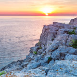 Sea and rock at the sunset. Royalty Free Stock Image