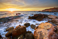 Sea and rock at the sunset Royalty Free Stock Image