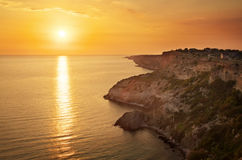 Sea and rock at the sunset. Royalty Free Stock Images