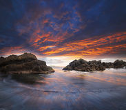 Sea and rock at the sunset. Nature stock photography