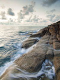 Sea and rock at the sunset in Samui Island Royalty Free Stock Image