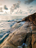 Sea and rock at the sunset in Samui Island Stock Photos