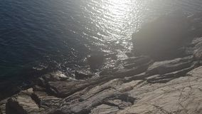 Sea on the rock. In a very sunny day with reflection stock video footage