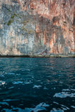 Sea and rock wall Stock Photography