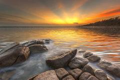 Sea rock wave at sunset Stock Photography