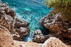 Sea and Rocks. Dangerous precipice Stock Photos