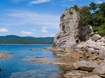 Sea and Rocks 6. A very small bay among fancy rocks. Seacoast of Petrova island - pearl of nature state reserve Lazovsky. Russian Far East, Primorye Stock Image