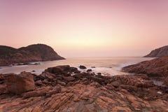 Sea rocks along the coast at sunrise Royalty Free Stock Photo